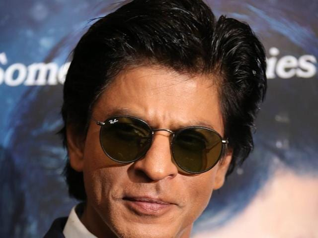 Shah Rukh Khan poses for photographers during the photo call for the film Dilwale in London.