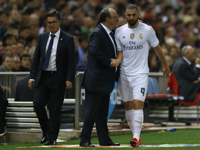 A file photo of Real Madrid's Karim Benzema and head coach Rafa Benitez during a Spanish La Liga  match between Real Madrid and Atletico Madrid at the Vicente Calderon stadium on October 4, 2015.