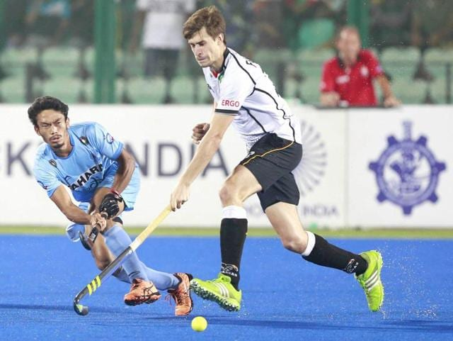 India and Germany players fight for the ball during the Hockey World League (HWL) Finals,in Raipur on November 28, 2015.
