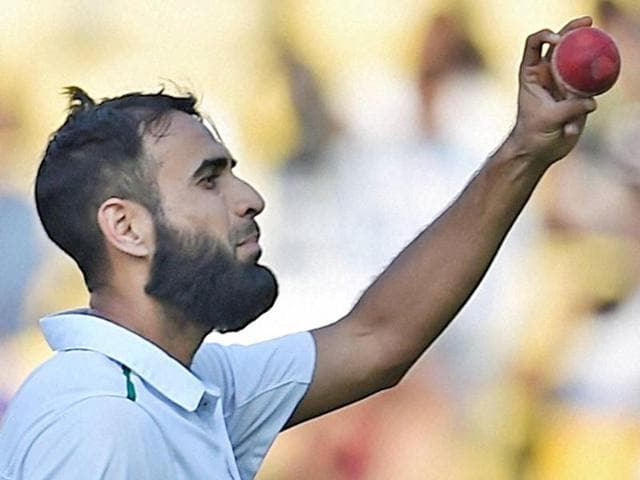 South African bowler Imran Tahir celebrates the wicket of Amit Mishra during the second day of the 3rd test match in Nagpur on November 26, 2015.