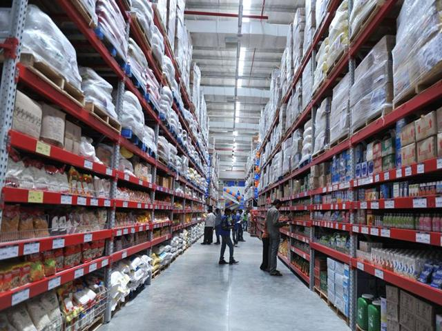 A file picture shows Indian shoppers browsing through the products of a newly opened Bharti Wal-Mart Best Price Modern wholesale store in Hyderabad.
