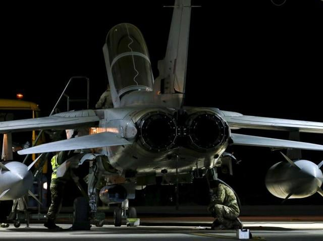 RAF personnel work on a British Tornado after it returned from a mission at RAF Akrotiri in southern Cyprus December 3, 2015.
