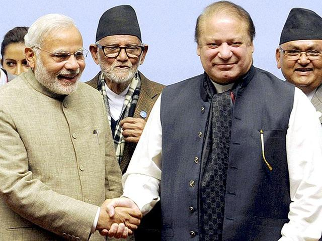 Prime Minister Narendra Modi shakes hands with his Pakistani counterpart Nawaz Sharif at the 18th SAARC Summit in Kathmandu.