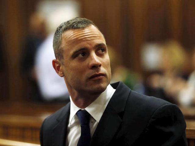 Olympic and paralympic track star Oscar Pistorius sits in the dock in the North Gauteng High Court in Pretoria in this May 6, 2014, file photo.