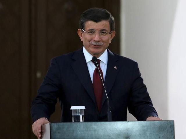 Turkish prime minister Ahmet Davutoglu speaks to the media during a visit to northern Cyprus.