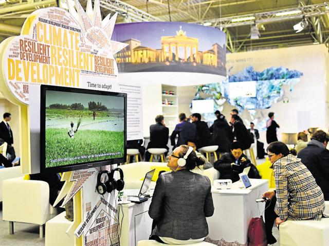 Guests visit a stand during the UN conference on climate change in Le Bourget on the outskirts of Paris on Thursday.