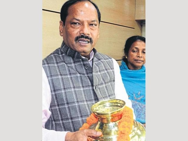 Chief minister Raghubar Das holds the remains of martyr Albert Ekka in Ranchi.