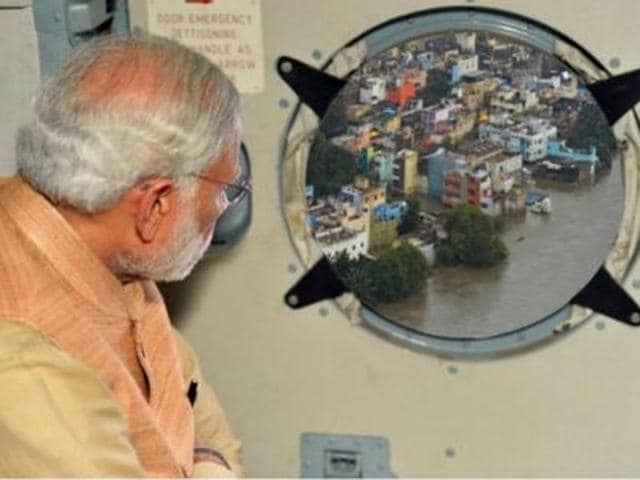 PIB released a photo showing PM Narendra Modi looking outside of an aircraft window to scenery that had been merged from another photograph.