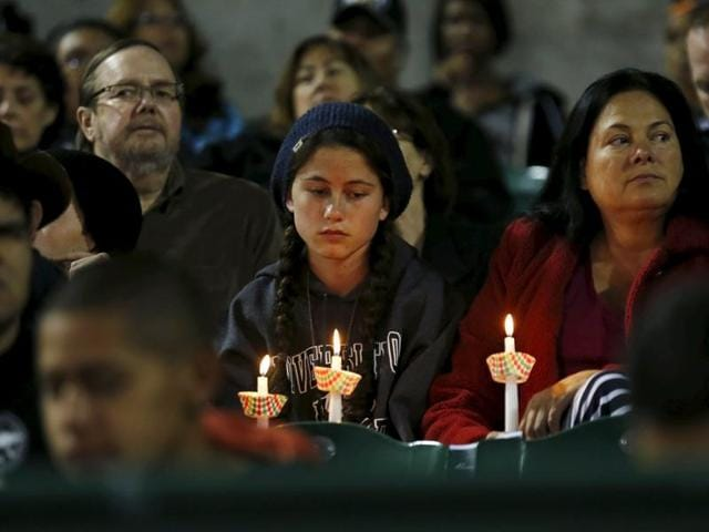 Attendees reflect on the tragedy of Wednesday's shooting attack during a candlelight vigil in San Bernardino, California, December 3, 2015