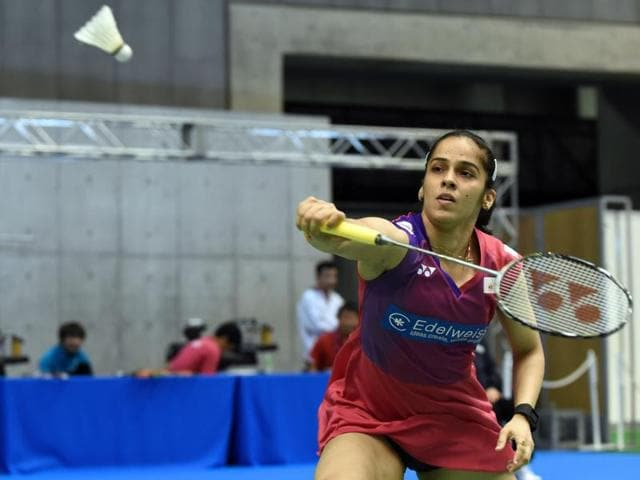Indian shuttler Saina Nehwal hits a return against Busanan Ongbumrungpan of Thailand during their Japan Open Superseries badminton tournament women's singles first round match in Tokyo on September 9, 2015.