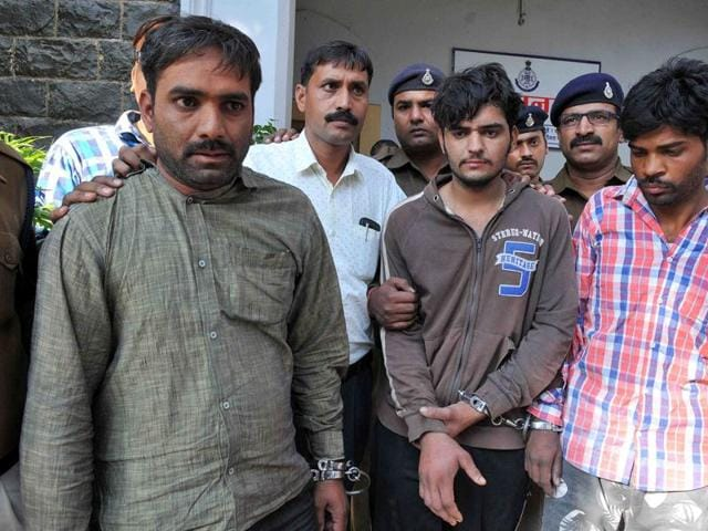 The murder accused in police custody in Indore on Friday.