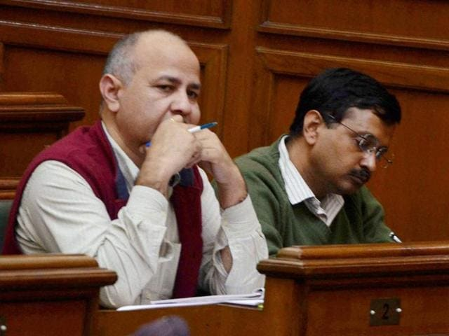 Delhi chief minister Arvind Kejriwal with Dy CM Manish Sishodia in the Delhi Assembly.