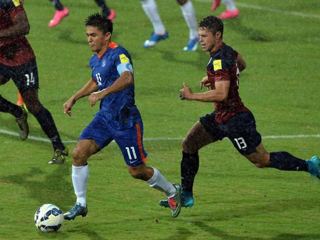 India captain Sunil Chhetri  takes the ball during the the Asia Group D FIFA World Cup 2018 qualifying football match between India and Guam at The Sree KanteeraVa Stadium in Bangalore on November 12, 2015.