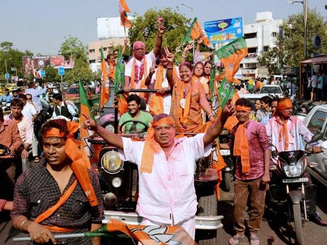 A BJP candidate celebrates his victory in Municipal election.