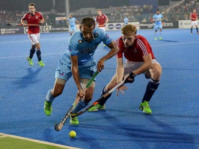 India and Great Britain players fight for the ball during the Hockey World League (HWL) quarterfinal match in Raipur on December 3.
