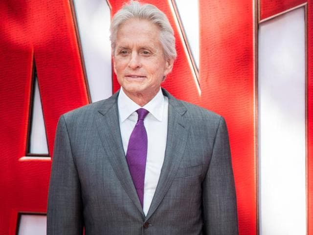 Michael Douglas poses for photographers upon arrival at the premiere of the film Ant Man, in London.