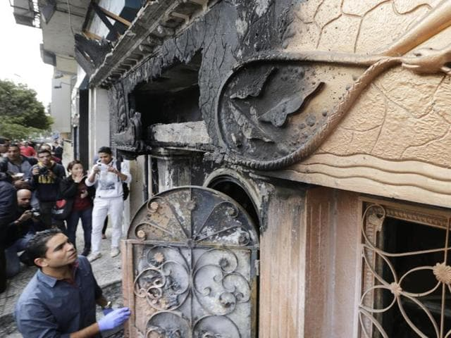 An Egyptian forensic member checks the entrance of a nightclub which was attacked in Cairo, Egypt.