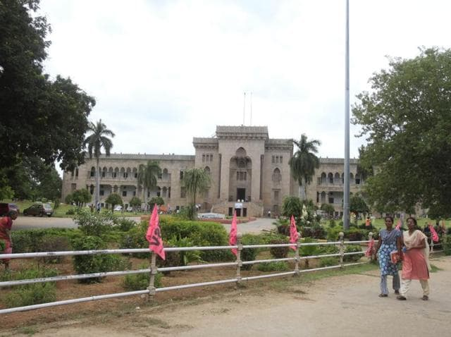 Students walks in front of Arts college at Osmania University campus in Hyderabad.