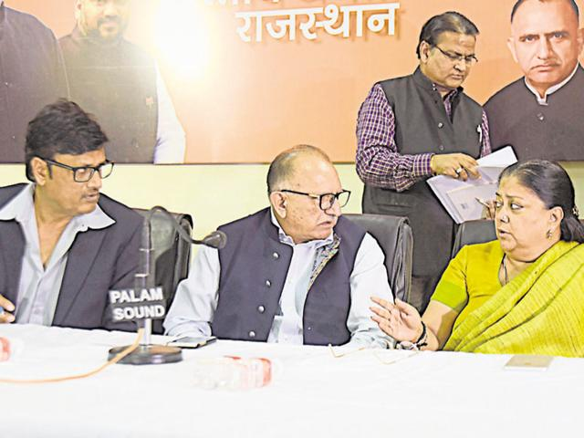CM Vasundhara Raje with BJP state chief Ashok Parnami (centre) and minister Rajendra Rathore at the party office in Jaipur.