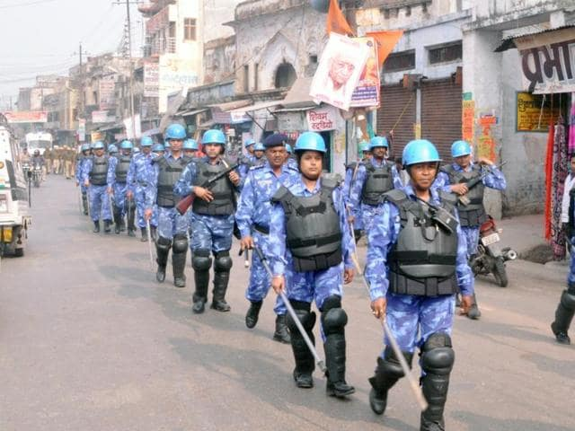 Paramilitary forces conduct a route march in the twin cities of Faizabad and Ayodhya on Friday. The district administration is on high alert as the 23rd anniversary of the Babri Masjid demolition approaches on December 6.