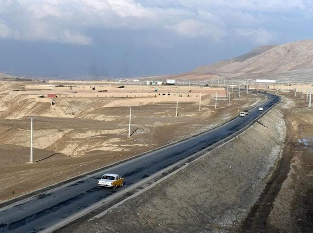 Afghan local vehicles travel on the highway to Maidan Wardak province west of Kabul. Drivers say the country's ethnic Hazara minority are slaughtered by militants