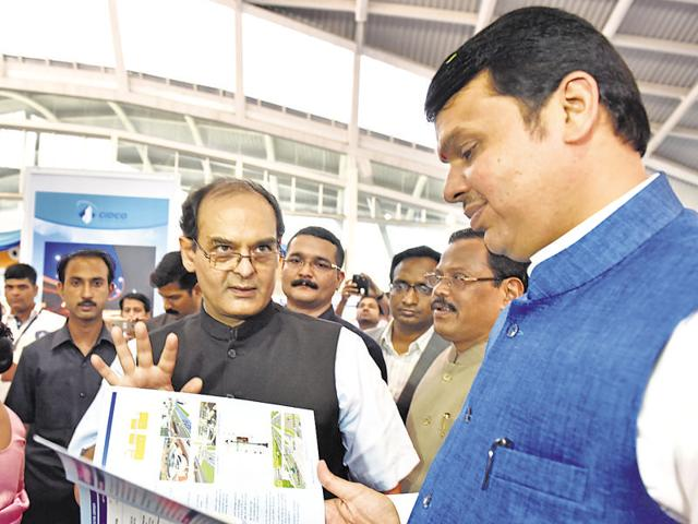 Maharashtra CM Devendra Fadnavis looks at the blueprints of Cidco's Smart City project at Cidco Exhibition Centre, Vashi, on Friday.