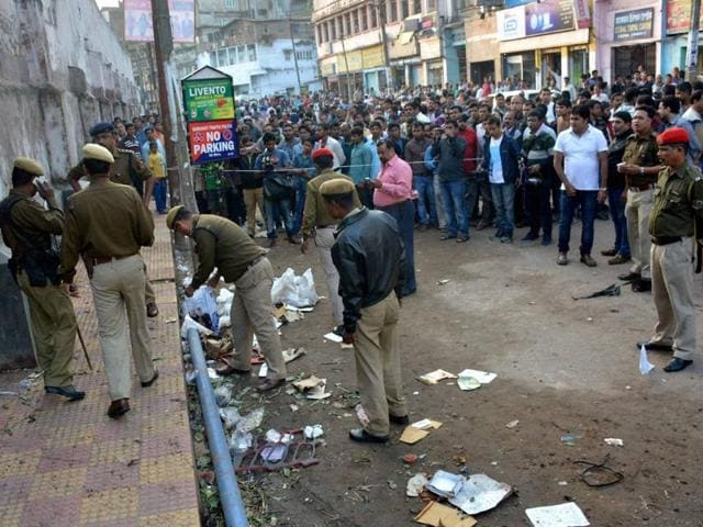 Police officials inspecting the blast site at Jail Road in Guwahati.