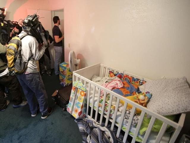 Members of the media crowd into a child's room inside the home of suspects Syed Rizwan Farook and Tashfeen Malik in Redlands, California.(AP)