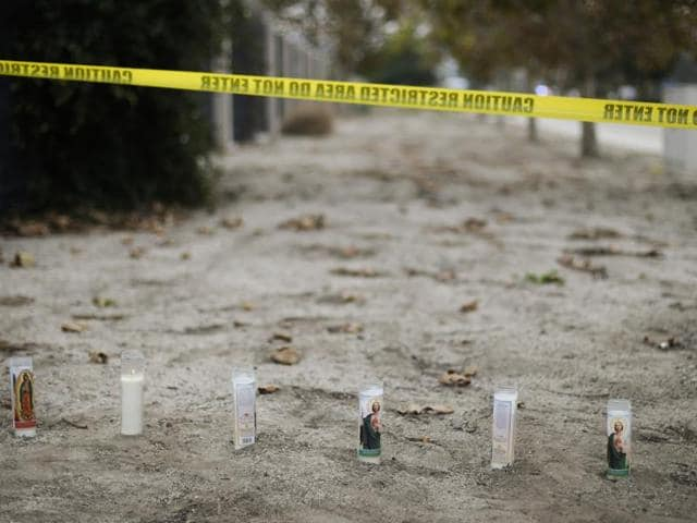 Candles are placed at a makeshift memorial site honouring the victims of Wednesday's shooting rampage in San Bernardino, California.