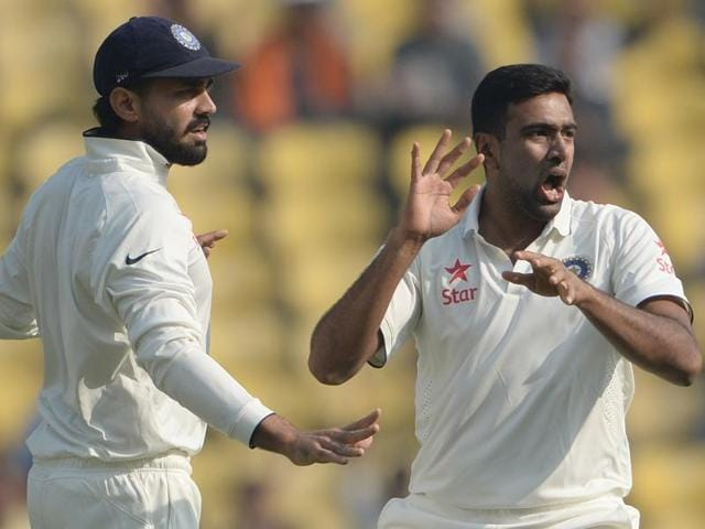 India's Ravichandran Ashwin (R) celebrates with teammate Murali Vijay after taking the wicket of South Africa's Dean Elgar during play on the second day of the third Test cricket match between India and South Africa at The Vidarbha Cricket Association Stadium in Nagpur on November 26, 2015.