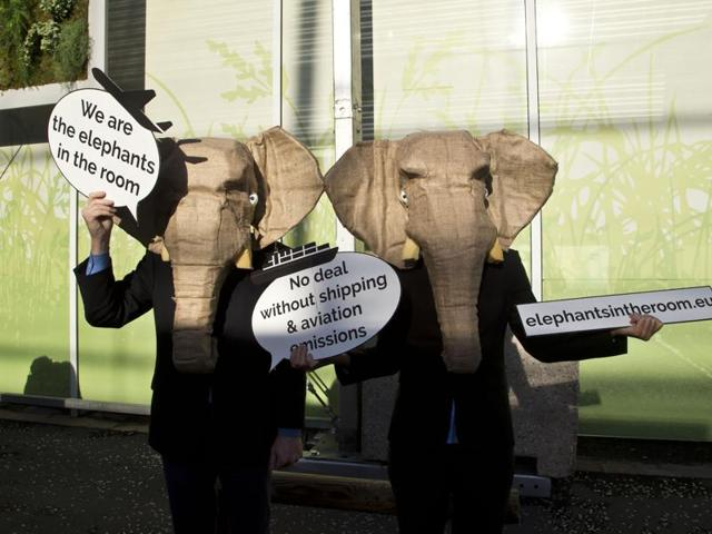 Representatives of NGOs wear elephant masks and hold banner at the COP21, United Nations Climate Change Conference, in Le Bourget north of Paris.