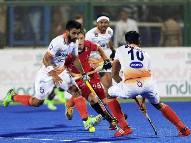 Players of India and Belgium (in red jersey) in action during the second semifinal of the Hockey World League in Raipur.