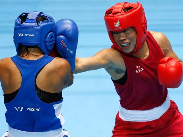 A file photo of Mary Kom against Kazakhstan's Zhaina Shekerbekova (blue) in the women's fly (48-51kg) boxing match final at the Seonhak Gymnasium during the 2014 Asian Games in Incheon.