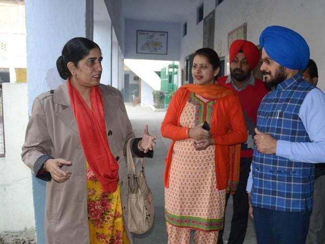 Chairman of PSEB Dr Tejinder Dhaliwal (L) interacting with DEO (SE) Satinderbir Singh (R), principal Mandeep Kaur (C) of Government Girls Senior Secondary School in Amritsar on Saturday.