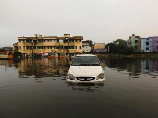 A car is seen in the floodwaters in Chennai.