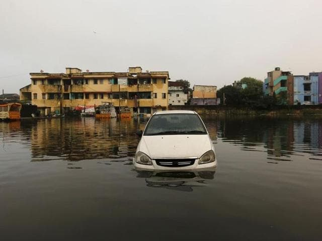A car is seen in the flood waters at a neighbourhood in Chennai on  December 4, 2015.  The flood-ravaged city is struggling to return to normalcy with partial restoration of telecommunication and train services.