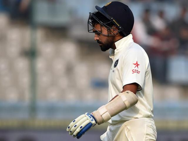 India's Murali Vijay walks back to the pavilion after he was dismissed by South Africa's Morne Morkel on the third day of the fourth Test match at The Feroz Shah Kotla Stadium in New Delhi on December 5, 2015.