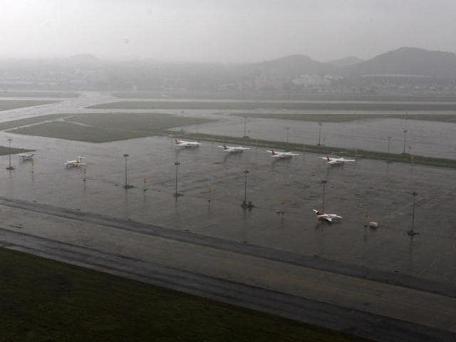 Planes are seen parked at waterlogged Chennai airport on Saturday.(PTI)