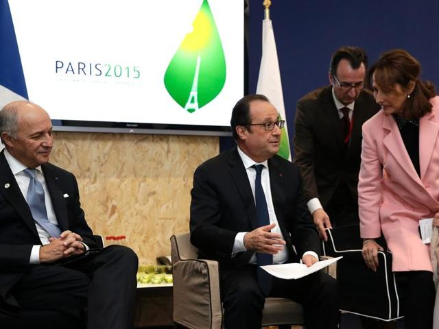 French President Francois Hollande (C) with foreign affairs minister Laurent Fabius (L) and president-designate of COP21 and ecology minister Segolene Royal at World Climate Change Conference 2015 (COP21) at Le Bourget near Paris on Saturday.