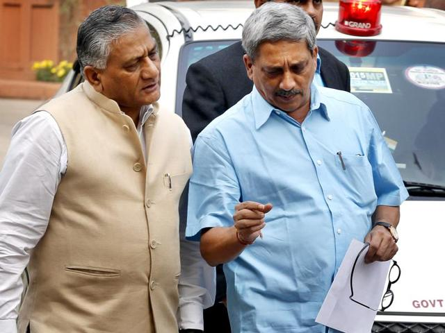 Defence Minister Manohar Parrikar and Minister of State for External Affairs V K Singh coming out from the BJP Parliamentary Party meeting in New Delhi.