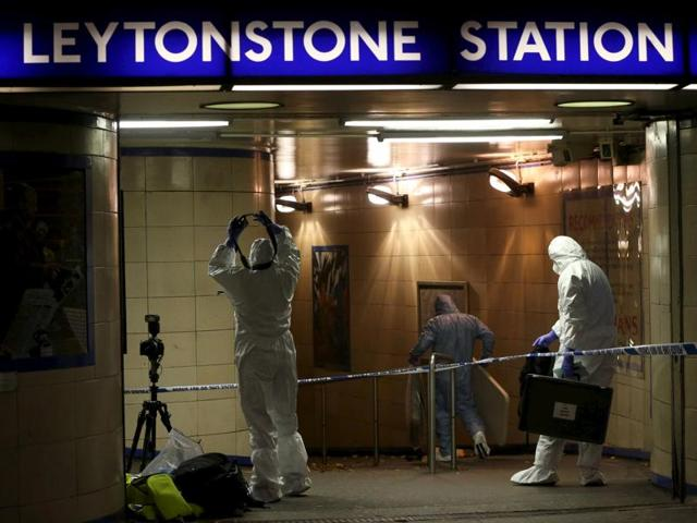 Police tape is seen at the Leytonstone Underground Station in east London, where a man stabbed one person and reportedly injured two others on December 6, 2015.