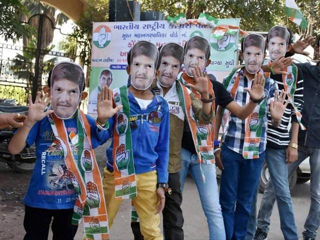 Youngsters wearing masks of PAAS convener Hardik Patel during a Congress campaign for Surat municipal corporation elections.