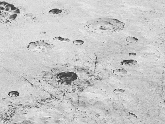 Pluto's icy cratered plains, including layering in the interior walls of many craters, are seen in this high-resolution image from NASA's New Horizons spacecraft released on December 4, 2015.