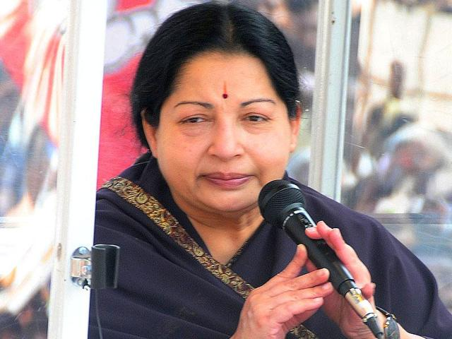 Tamil Nadu chief minister and AIADMK chief J Jayalalithaa attending the party's executive meeting in Chennai. Local journalists have shown more enthusiasm than before to help journalists from other papers to cover the Chennai floods, because they were protected from having a defamation case filed against them.(HT Photo)