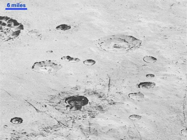 This handout picture obtained from NASA on December 5, 2015 shows an image taken from NASA's New Horizons spacecraft showing great blocks of water-ice crust jammed together in the informally named al-Idrisi mountains on the planet Pluto.