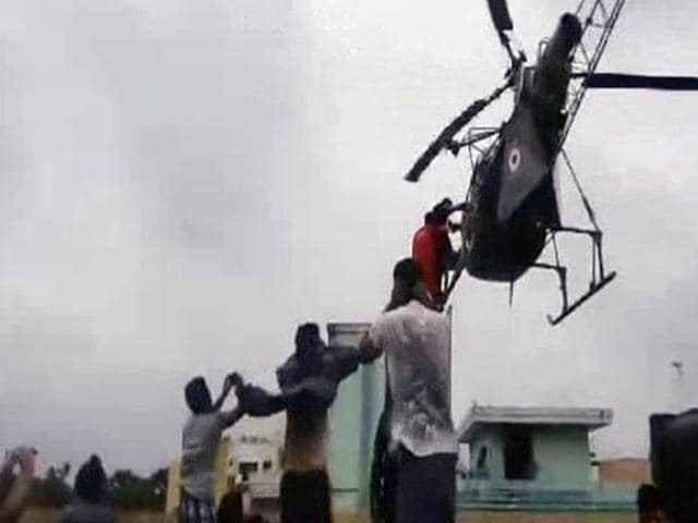 A nine-month pregnant woman,Deepthi Velchamy, being airlifted to safety by an IAF helicopter inChennai. Mrs. Velchamy went into labour and gave birth to healthy twin girls at a hospital in the city on Monday.