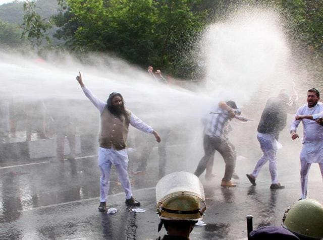 Police used water cannons to disperse Aam Aadmi Party activists during a protest march on the Chandigarh-SAS Nagar border on Sunday.