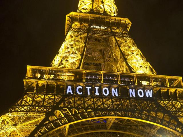 The Eiffel Tower lights up with the slogan