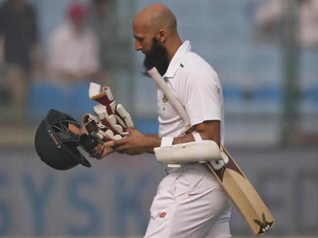Hashim Amla walks back to the pavilion after his dismissal.