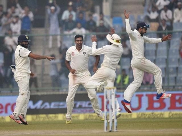 Virat Kohli and his teammate Ravindra Jadeja and others celebrate the dismissal of South Africa player during final day of the fourth Test match at Feroz Shah Kotla Stadium in New Delhi on Monday.
